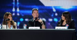 """The X Factor"" judges Paula Abdul and Simon Cowell and top finalist Melanie Amaro atrend ""The X Factor"" news conference in Los Angeles"