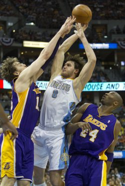 Lakers Gasol Blocks Nuggets Gallinari During the NBA Western Conference Playoffs First Round Game Three in Denver