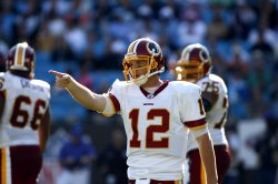 Washington Redskins quarterback John Beck (12) looks to pass argues a call as the Redskins play the Carolina Panthers