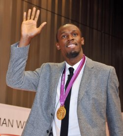 Usain Bolt holds a press conference in Tokyo