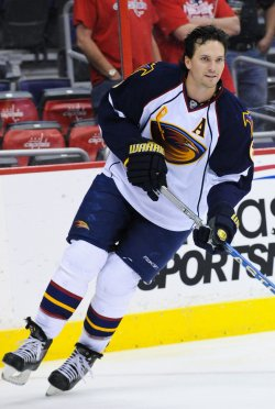 Thrashers Hainsey warms up against Capitals in Washington