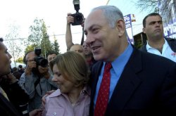 FORMER PRIME MINISTER BENJAMIN NETANYAHU CAMPAIGNS OUTSIDE A POLLING STATION IN JERUSALEM