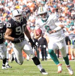 Matt Moore rushes in Miami