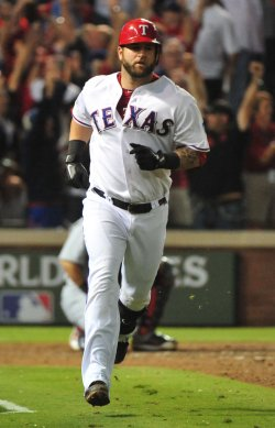 Rangers Mike Napoli blasts a three run homer in 6th inning of game 4 of the World Series in Texas