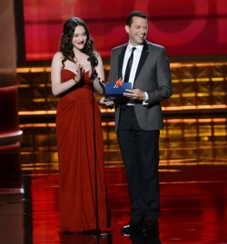 Kat Dennings and Jon Cryer attend the 64th Primetime Emmy Awards in Los Angeles