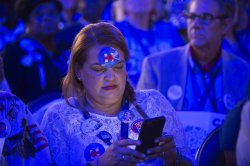 Delegate views phone at the DNC convention in Philadelphia