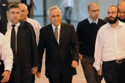 Former Israeli President Moshe Katsav arrives in the Supreme Court in Jerusalem