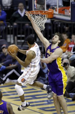 Charlotte Bobcats guard Gerald Henderson shoots over L.A. Lakers' Pau Gasol