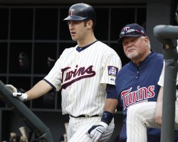 Twins Mauer and Gardenhire wait in dugout in Minneapolis