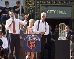 Mayor Gavin Newsom gives key to the city to Bill Neukom at a civic celebration in San Francisco