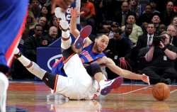 Detroit Pistons Tayshaun Prince and New York Knicks Iman Shumpert dive for a loose ball at Madison Square Garden in New York