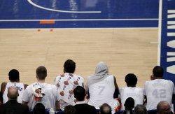 Knicks Kristaps Porzingis and Carmelo Anthony on the bench