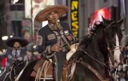 Charros de La Puente perform in the 84th Annual Hollywood Christmas Parade in Los Angeles