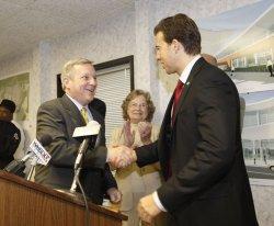 Giannoulias, Durbin shake hands in Peoria, Illinois