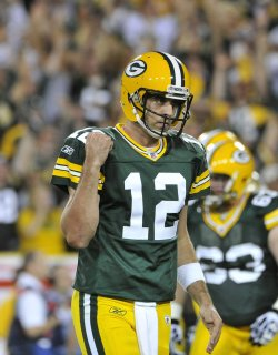 Packers' Rodgers celebrates touchdown against Saints in Green Bay, Wisconsin