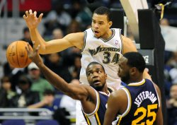 Wizards' JaVale McGee goes for a rebound in Washington