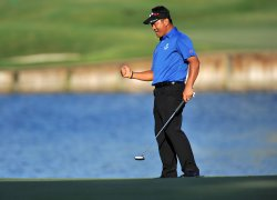 K.J. Choi pumps his fist during the TPC Players in Florida