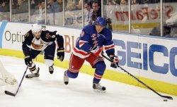 New York Rangers Vaclav Prospal skates past Atlanta Thrashers Ron Hainsey in the third period at Madison Square Garden at Madison Square Garden
