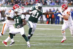 New York Jets LaDainian Tomlinson looks to stiff arm Kansas City Chiefs Sabby Piscitelli at MetLife Stadium in New Jersey