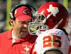 Kansas City Chiefs coach Todd Haley defeats the Raiders in Oakland, California