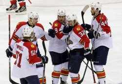 Florida Panthers react to a goal in New Jersey