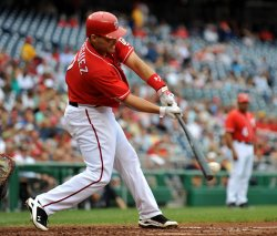 Nationals' Ivan Rodriguez connects for a single in Washington