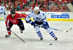 Leafs Dion Phaneuf carries the puck against Capitals Marcus Johansson in Washington
