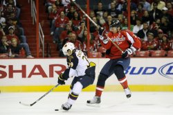 Enstrom takes the puck away from Semin in Washington, DC