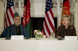 Afghan President Hamid Karzai meets with U.S. Secretary of State Clinton in Washington