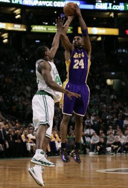 Lakers Bryant scores on Celtics Allen in Boston, MA.