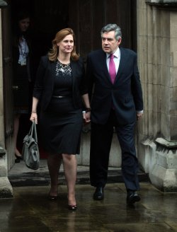 Former Prime Minister Gordon Brown leaves the Leveson Inquiry in London
