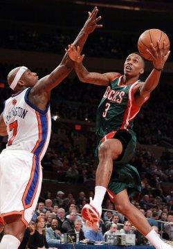Milwaukee Bucks Brandon Jennings (3) drives to the basket past New York Knicks Al Harrington at Madison Square Garden