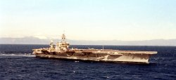 USS Kitty Hawk sails by Mt. Fuji