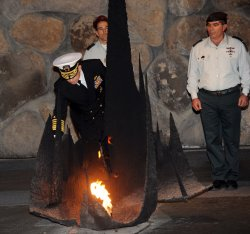 Chairman of the U.S. Joint Chiefs of Staff, Admiral Michael Mullen rekindles the eternal flame at the Yad Vashem Holocaust Museum in Jerusalem
