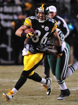 Steelers' Heins Ward is tackled by New York Jets' David Harris in Pittsburgh