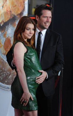 "Alyson Hannigan and Alexis Denisof attends the ""American Reunion"" premiere in Los Angeles"
