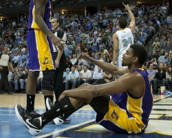 Lakers Bynum Looks for Help Getting Off the Floor Against the Nuggets During the NBA Western Conference Playoffs First Round Game Six in Denver