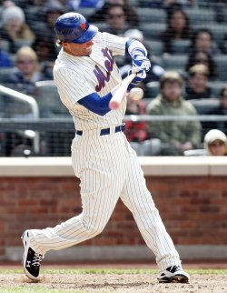 New York Mets Jeff Francoeur reaches first base at Citi Field in New York