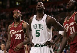 Celtics Garnett and Cavaliers James watch free throw in Boston, MA.
