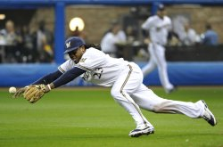 Brewers' second baseman Rickie Weeks dives for a ball during game 6 of NLCS in Milwaukee, Wisconsin