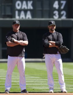 Rockies First Baseman Giambi and Helton Wait for their Turn in Batting Cage in Denver