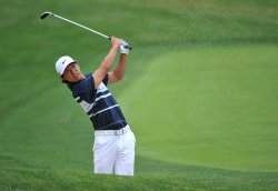 Anthony Kim hits from a bunker on the 15th hole at the US Open in Maryland