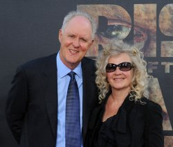 "John Lithgow and Mary Yeager attend the ""Rise of the Planet of the Apes"" premiere in Los Angeles"