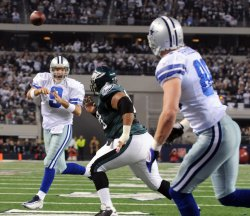 Cowboys Tony Romo throws to Phillips for a touchdown