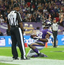 Viking's Adrian Peterson celebrates a touchdown
