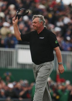 Darren Clarke receives applause during the Open Championship in England.