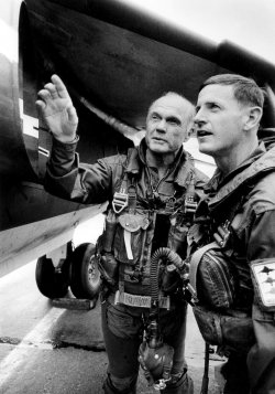 JOHN GLENN TALKING WITH PILOT JIM PHILLIPS FOLLOWING TEST FLIGHT IN HARRIER JET