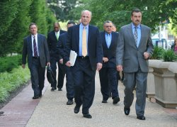 Police Chiefs leave the DOJ after discussing Arizona's new immigration law with Eric Holder in Washington