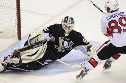 Senators Conarcher Shot Blocked By Penguins Vokoun in Pittsburgh