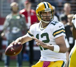 Green Bay's Rodgers passes against San Francisco 49ers